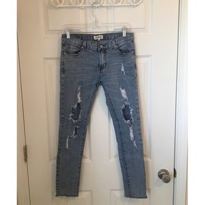Listicle light wash distressed jeans